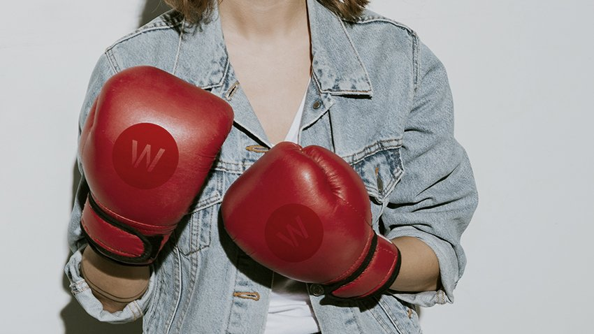 woman with wpromote boxing gloves