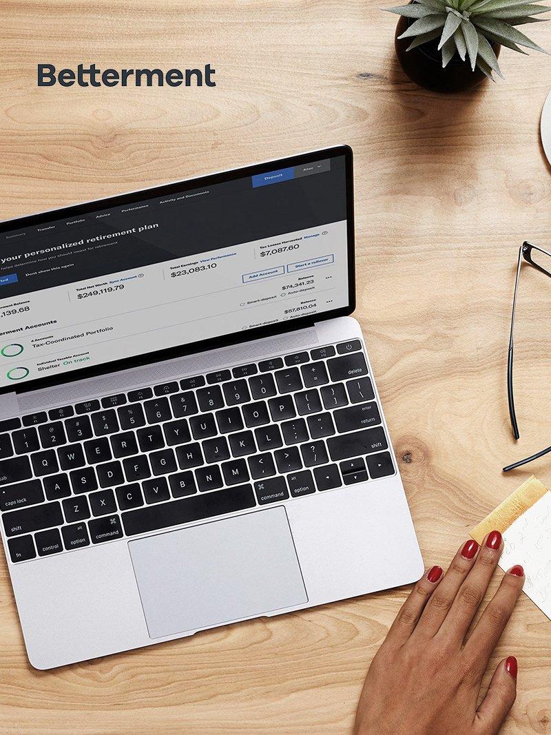 betterment on laptop on desk