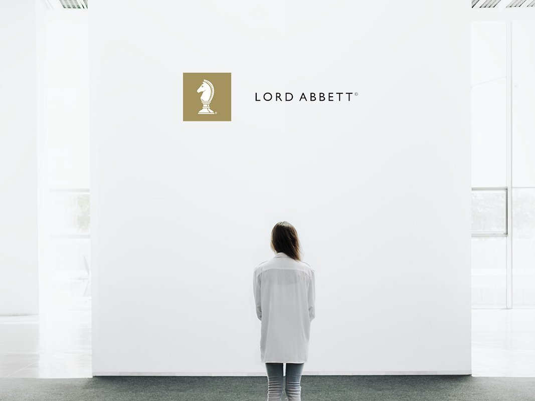woman standing looking at blank wall