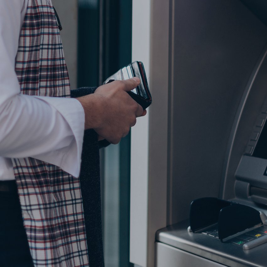 man with wallet at atm