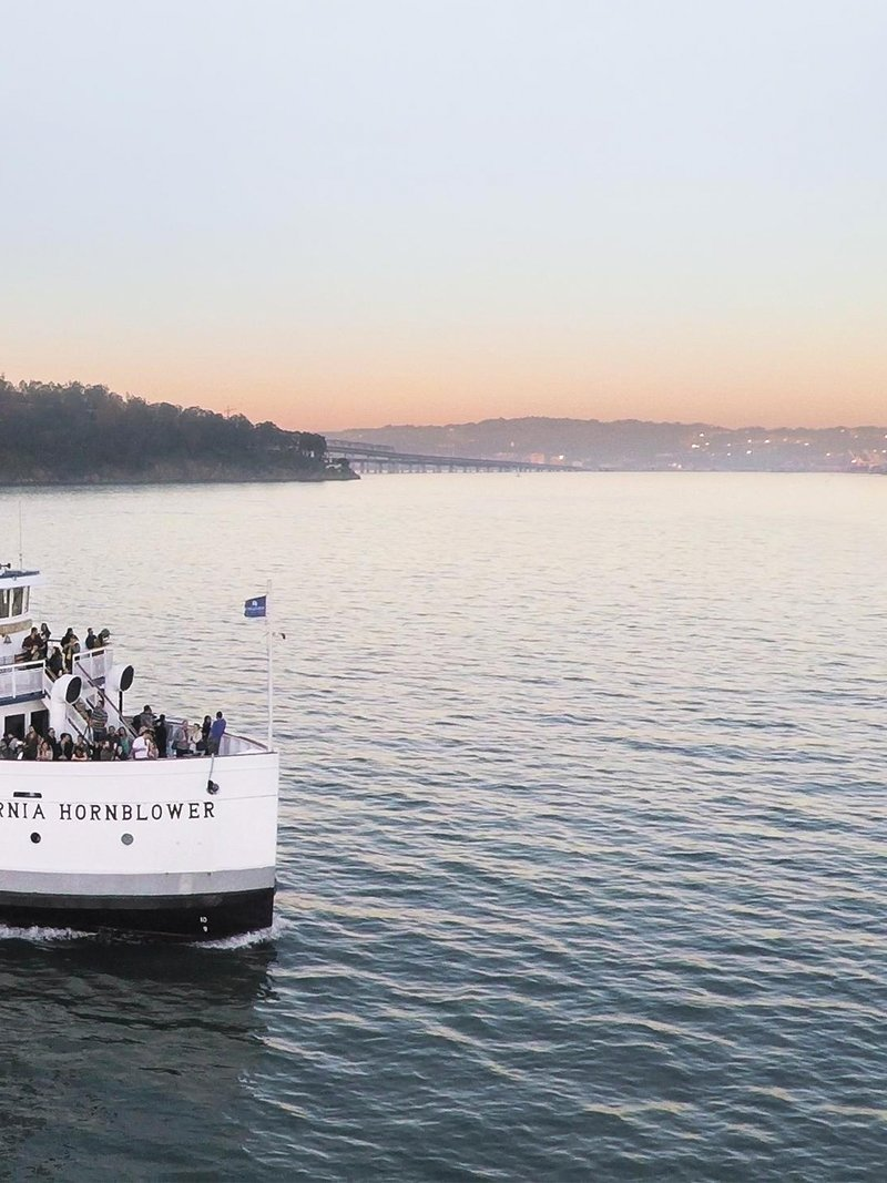 hornblower boat in bay at sunset