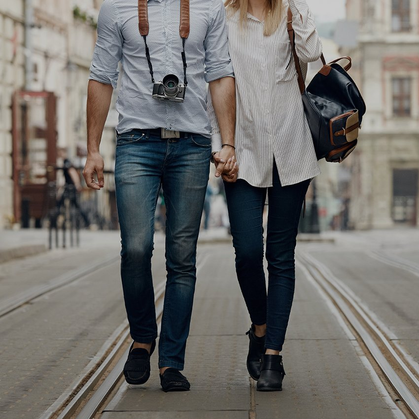 Tourist couple walking in the street
