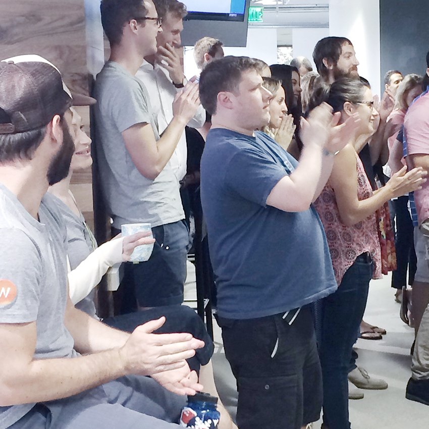 Wpromote team clapping