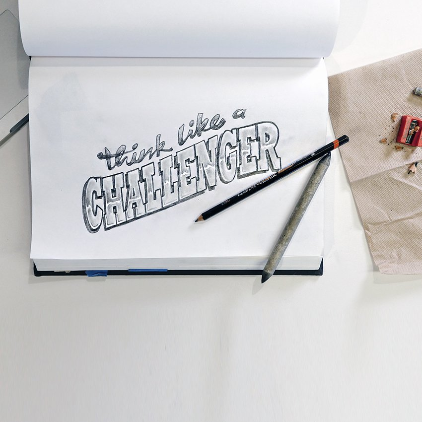 Think Like A Challenger written in a notebook