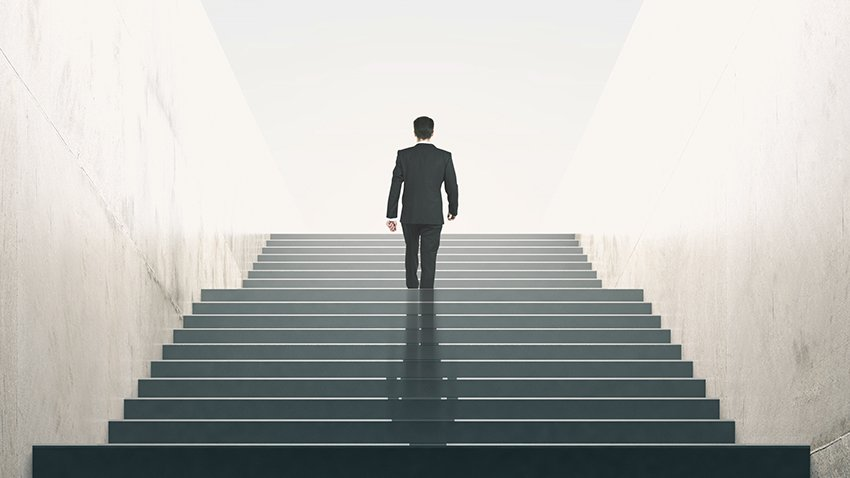 man walking up tall stairs