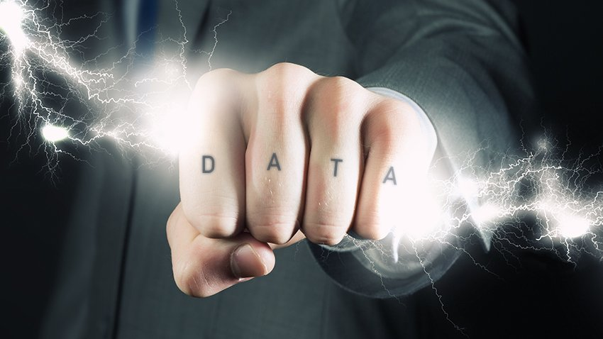 Hand holding a lightning bolt with data tattoo