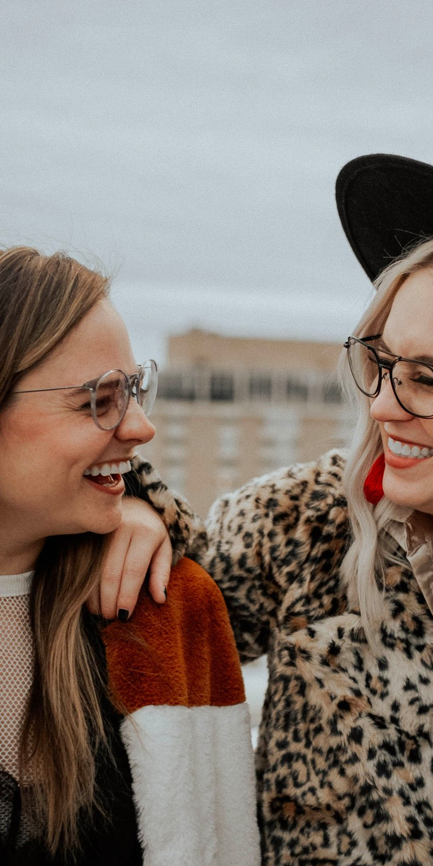 two women laughing in zenni glasses