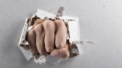 Hand punching through wall