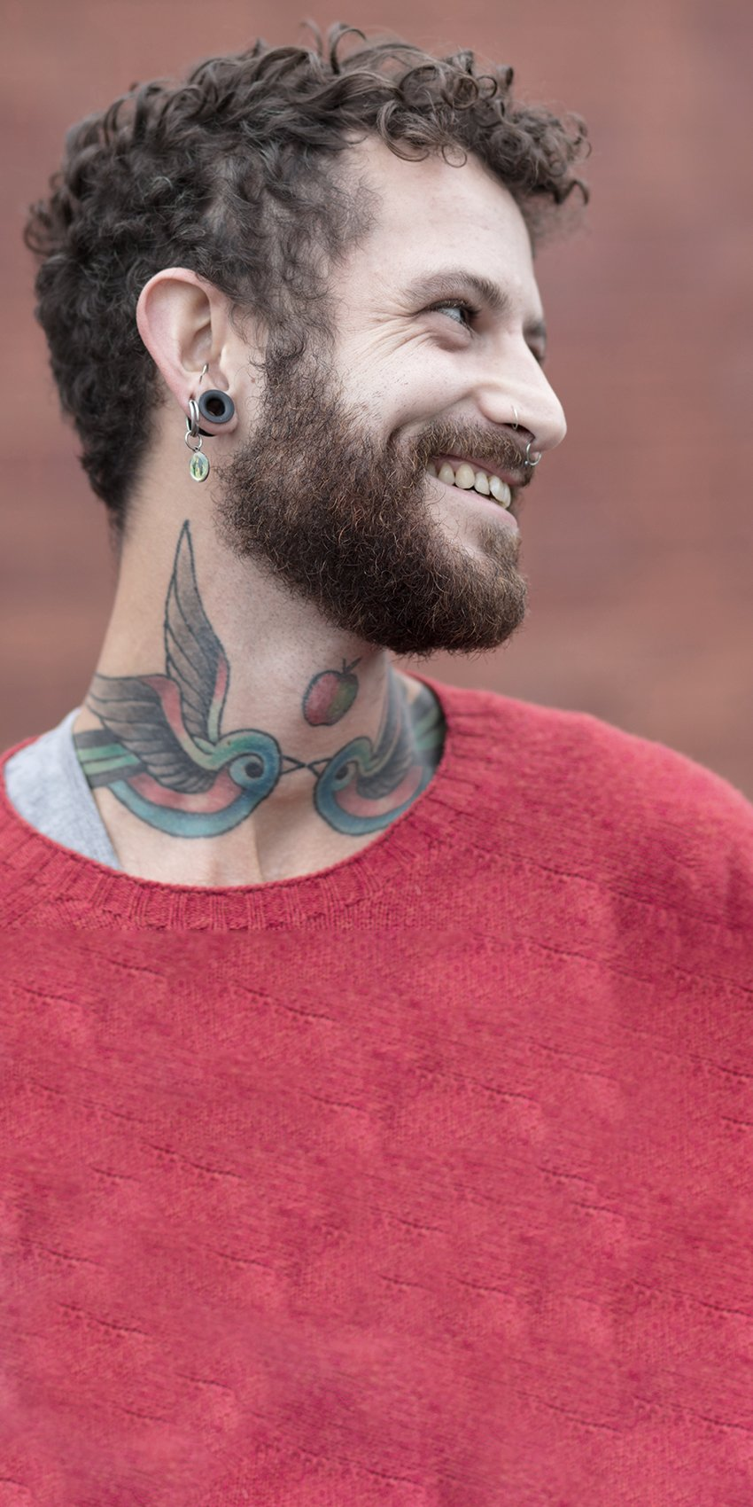 Man with tattoo and ear piercing