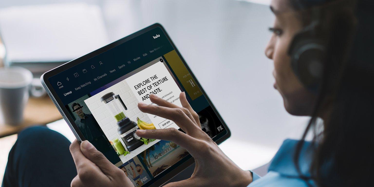 woman watching Hulu on tablet