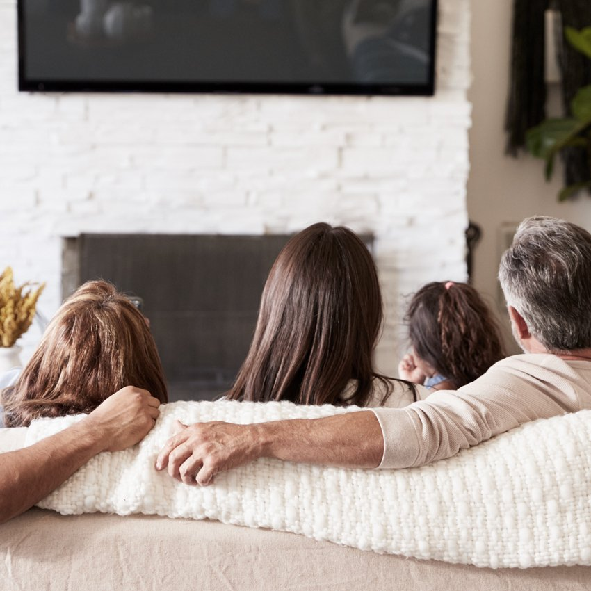 family on couch watching tv