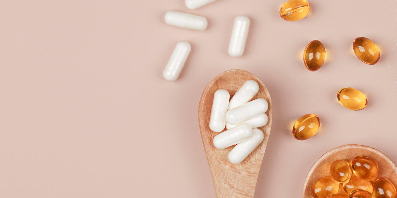 vitamins on tan background